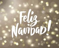 Feliz Navidad text. Holiday greetings spanish quote isolated on white. Great for Christmas cards, gift tags and labels. Feliz Navidad text, hand drawn brush Stock Photo
