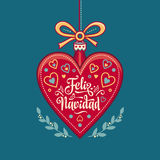 Feliz navidad. Xmas card on Spanish language. Warm wishes for happy holidays Stock Photo