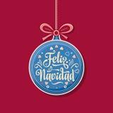 Feliz navidad. Xmas card on Spanish language. Warm wishes for happy holidays in Spain. English translation: Merry Christmas Stock Photo