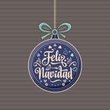 Feliz navidad. Xmas card on Spanish language. Warm wishes for happy holidays in Spain. English translation: Merry Christmas Stock Photography