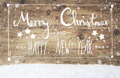 Feliz Navidad y Feliz Año Nuevo, fondo del vintage, copos de nieve de la caligrafía Foto de archivo libre de regalías