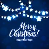 Feliz Navidad y Año Nuevo Garland Light Design en fondo azul Fotografía de archivo