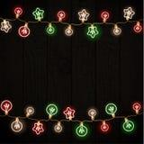 Feliz Navidad y Año Nuevo Garland Light Design en fondo negro Foto de archivo libre de regalías