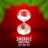Feliz Navidad y Feliz Año Nuevo con reloj de arena Fotos de archivo