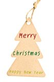 Feliz Navidad y Feliz Año Nuevo en etiqueta en blanco Imagenes de archivo