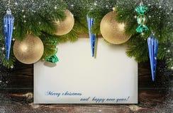 Feliz Navidad y una Feliz Año Nuevo Fotografía de archivo libre de regalías