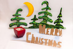 Feliz Navidad y vela Imagen de archivo libre de regalías