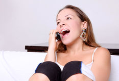 Feliz no telefone Fotografia de Stock