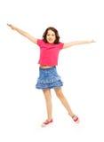 Feliz saltando 11 años de muchacha Fotos de archivo