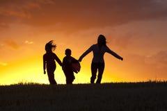 Feliz saltando adelante Imagen de archivo libre de regalías