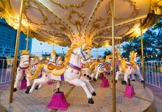 Feliz van los caballos de la ronda con nadie, lente ancha Fotografía de archivo libre de regalías