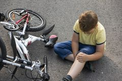 Fell down of his first bike on road.  royalty free stock photos