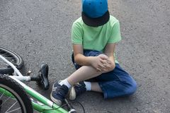 Fell down of his first bike on road.  royalty free stock photo