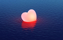 Fell heart floating over water Stock Images