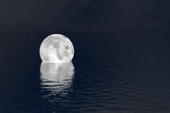 Fell moon over water night scene background. Moon floating on reflective dark ocean. Fictional night scene. Peaceful dream. Moonlight dreamland scene Royalty Free Stock Photography