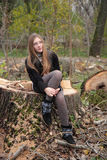 Felled trees and a girl. Stock Image