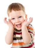 Fellgesicht des kleinen Jungen unter Händen Lizenzfreie Stockbilder