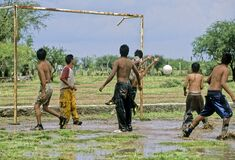 Fellow gamers have fun with just a soccer ball on a muddy field
