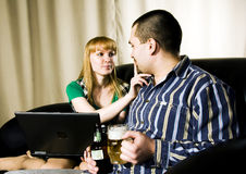 Fellow and girl. A girl holding a notebook to drink beer a zapreshaet fellow Royalty Free Stock Photos