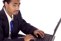 Fellow on his laptop. Young man on his laptop looking at you Royalty Free Stock Photo