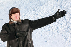 Fellow stands on snow, shows hands direction Stock Images