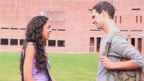 Fellow students flirting stock footage