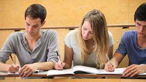 Fellow students taking notes Royalty Free Stock Images