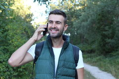 Fellow tourist calling by phone phone in the forest.  royalty free stock image
