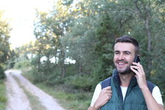 Fellow tourist calling by phone phone in the forest.  royalty free stock photos