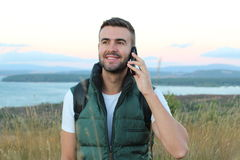 Fellow tourist calling by phone phone in the mountains with a gorgeous view royalty free stock images