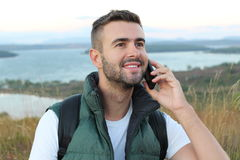 Fellow tourist calling by phone phone in the mountains with a gorgeous view royalty free stock photography