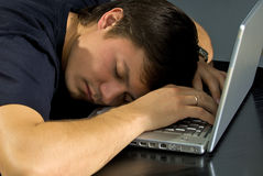 Fellow will sleep. After the computer Royalty Free Stock Image