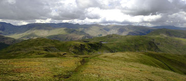 The fells of Hartsop. Sunlight on the Hartsop fells from Rest Dodd Royalty Free Stock Images