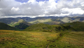 The fells of Hartsop. Sunlight on the Hartsop fells from Rest Dodd Stock Photography