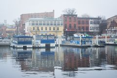 The Fells Point waterfront in fog, in Baltimore, Maryland.  stock photos