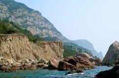 Felsen auf dem Strand Stockbild