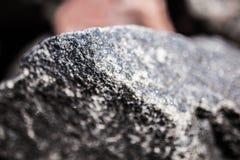 Felsen auf dem Strand Stockfoto