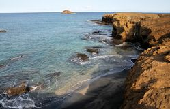 Felsen auf der Küstenlinie Stockbild