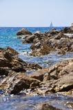 Felsen auf einem Strand Stockbild