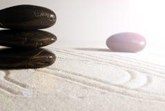 Felsen auf Sand Stockbild