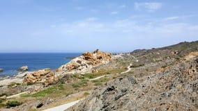 Felsen an einer Strandlandschaft Stockfotografie