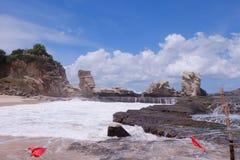 Felsen im Strand Stockbild