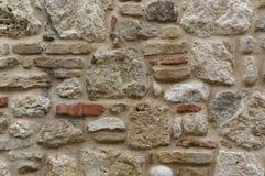 Felsen- und Marmorwand Alte Backsteinmauer Stockfoto