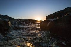 Felsen und Sun Stockbilder