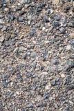 Felsige Beschaffenheit mit Sand Hintergrund Stockfoto