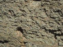 Felsige Steinwandbeschaffenheit stockfoto