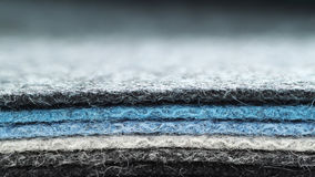 Felt. A pile grey and blue sheets of felt stock photography