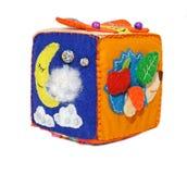 Felt activity developing cube, baby soft sensory toy. Isolated on white background Stock Photos