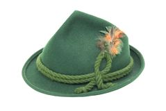Felt Alpine hat. Traditional green felt German alpine hat with rope twists and bright feathers - path included Royalty Free Stock Photos