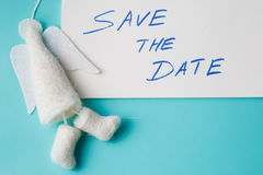 Felt angel with message save the date Stock Image